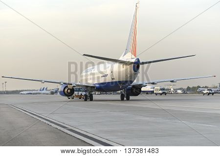 MOSCOW, RUSSIA - SEPTEMBER 26, 2014: Boeing 737 towed tractor maintenance Transaero Airlines has ceased to exist in 2015.
