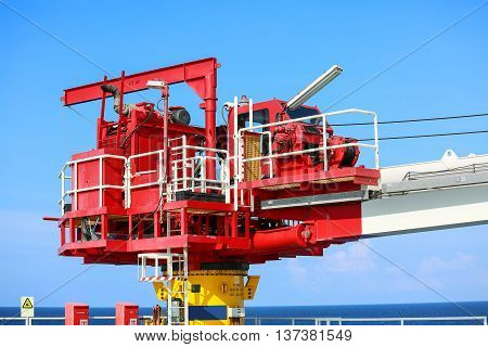 Crane construction on Oil and Rig platform for support heavy cargo, Transfer cargo or basket on work site, Heavy industry, heavy job on the oil and gas platform, Offshore operation on the platform.