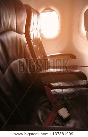 Lonely travel by airplane to somewhere, Journey for business by airplane and see out of airplane window, Sky view of Airplane from high level, Airplane interior for first class level and support VIP.