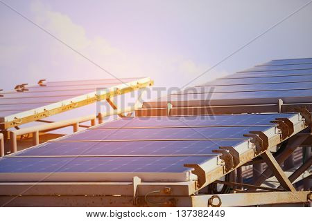 Solar Cell Generated Electrical Power by Sun Light, Closeup of Blue Photovoltaic Solar Panels, Green Energy for Safe World, Power Supply and Generated Electrical Power to Battery,
