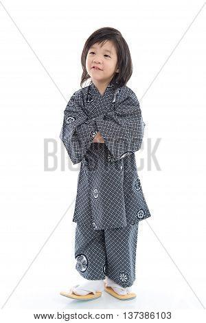 Happy asian boy in kimono on white background isolated