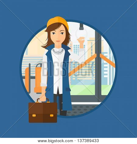 Woman traveling by public transport. Young woman standing inside public transport. Woman traveling by passenger bus or subway. Vector flat design illustration in the circle isolated on background.