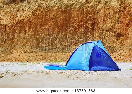 A touristic tent at the sea over the rocks