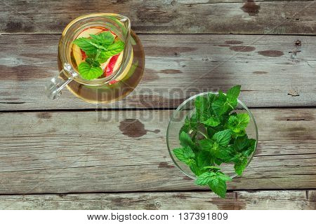 Decanter cool green tea with apples and mint flat lay