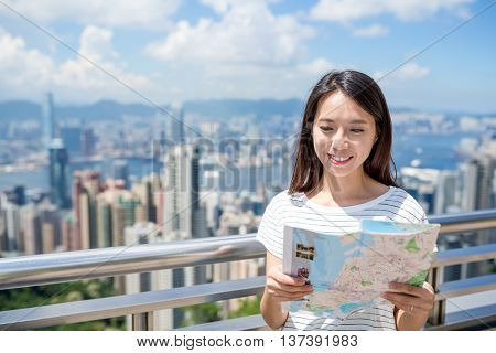 Woman checking on city map in Hong Kong city