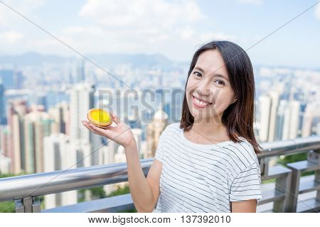 Woman holding famous local food