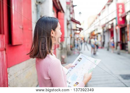 Woman using city map in Macao city
