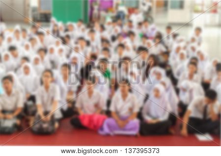 Blurred abstract background of university students sitting in a lecture roomTeachers day.
