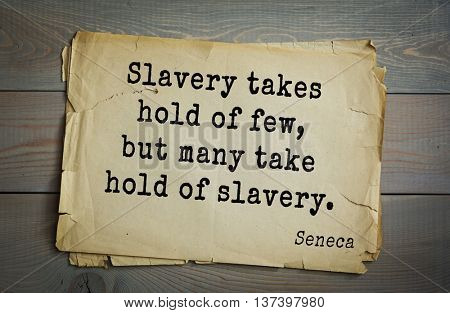 Quote of the Roman philosopher Seneca (4 BC-65 AD). Slavery takes hold of few, but many take hold of slavery.