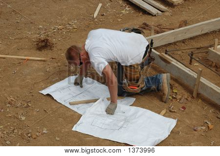 Construction Worker Looking At Plans