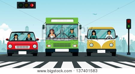 Car and bus stop at the traffic light at the crosswalk.