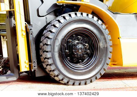 The front wheels of the forklift trucks close up