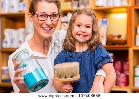 Family with pigment colors or paint in hardware store