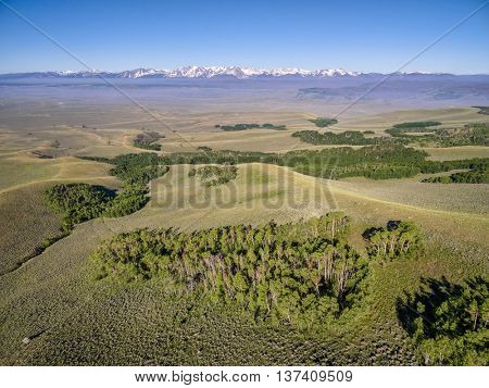 aerial view from Independence Mountain in North Park, Colorado towards Park Range with Mount Zirkel, summer scenery with wildfire smoke