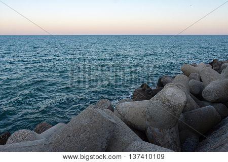 Breakwater on sea with horizon view .