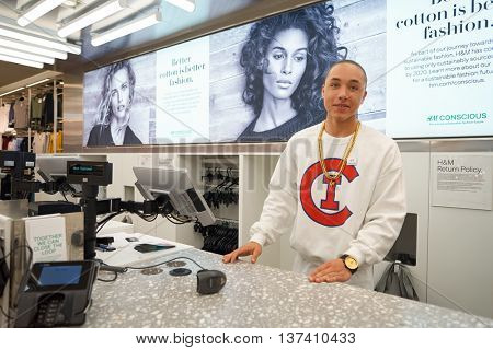 CHICAGO, IL - MARCH 24, 2016:  indoor portrait of workers at H&M store. H & M Hennes & Mauritz AB is a Swedish multinational retail-clothing company, known for its fast-fashion clothing.
