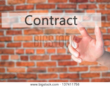Contract - Hand Pressing A Button On Blurred Background Concept On Visual Screen.