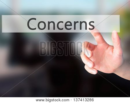 Concerns - Hand Pressing A Button On Blurred Background Concept On Visual Screen.