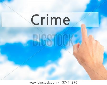 Crime - Hand Pressing A Button On Blurred Background Concept On Visual Screen.