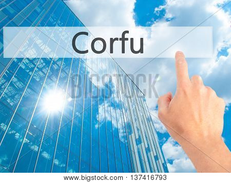 Corfu - Hand Pressing A Button On Blurred Background Concept On Visual Screen.