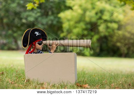 Boy pretending to be a pirate in park
