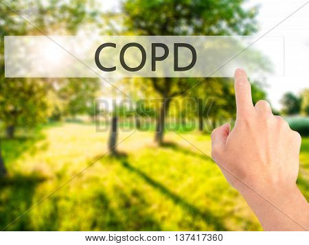 Copd - Hand Pressing A Button On Blurred Background Concept On Visual Screen.