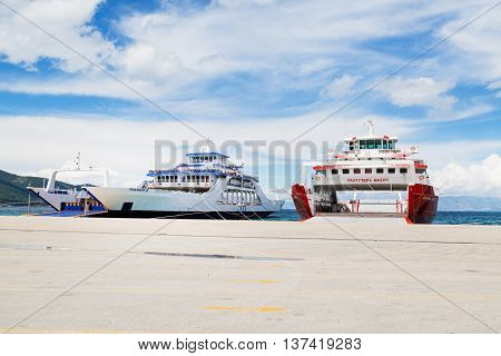Thassos, Greece - May 3, 2016: Thassos port and ferry boats ready for loading