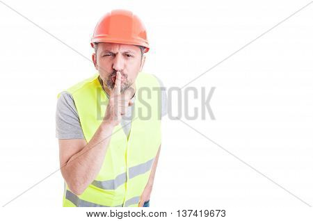 Constructor Doing A Quiet Or Shush Gesture