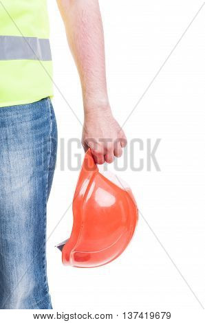 Young Constructor Hand Holding A Safety Hardhat
