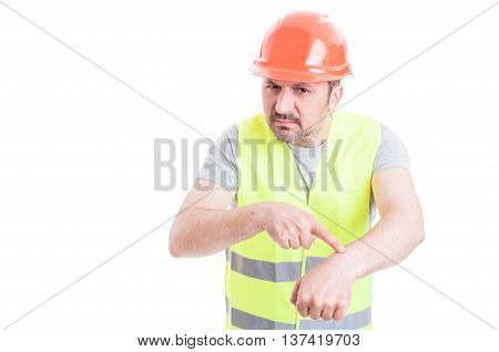 Angry Male Engineer Pointing At His Wrist