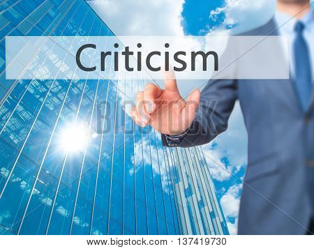 Criticism - Businessman Hand Touch  Button On Virtual  Screen Interface