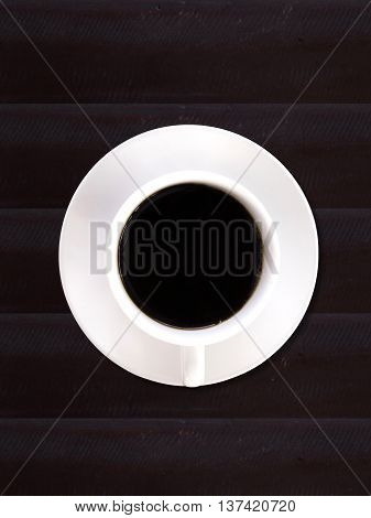 Cup of black coffee top view isolated on white background.