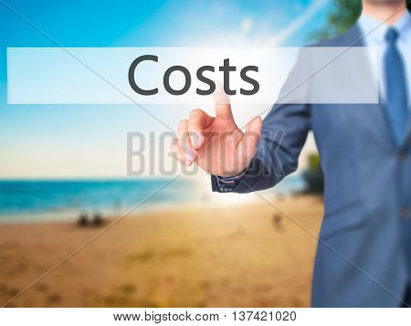 Costs - Businessman Hand Touch  Button On Virtual  Screen Interface