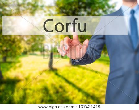 Corfu - Businessman Hand Touch  Button On Virtual  Screen Interface