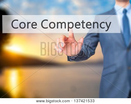 Core Competency - Businessman Hand Touch  Button On Virtual  Screen Interface