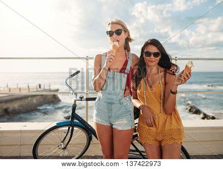 Female Friends With A Bike Eating Ice Cream