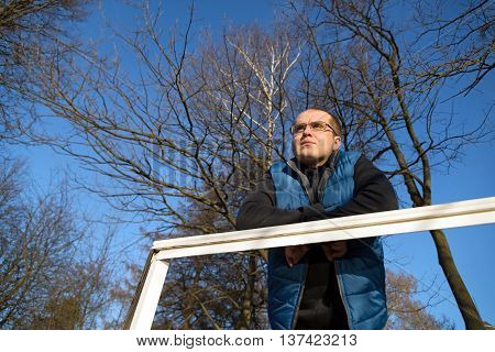 lonely sad man outdoors in autumn forest