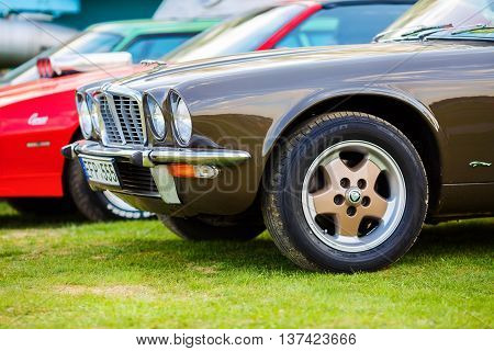 MINSK BELARUS - MAY 07 2016: Close-up photo of brown Jaguar XJ6 1976 model year. Vintage retro car. Selective focus.