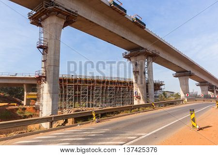 Construction industrial building  new road highway junction flyover ramps in progress.