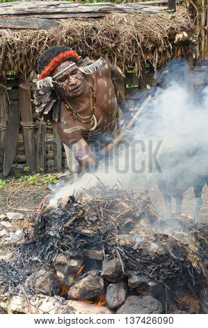 Warrior Of A Papuan Tribe In Traditional Clothes And Coloring