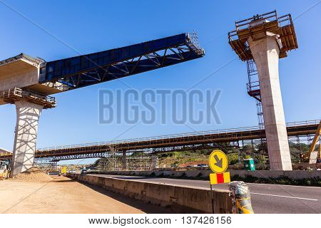 Construction industrial new traffic road highway intersection junction flyover ramps of concrete steel design.