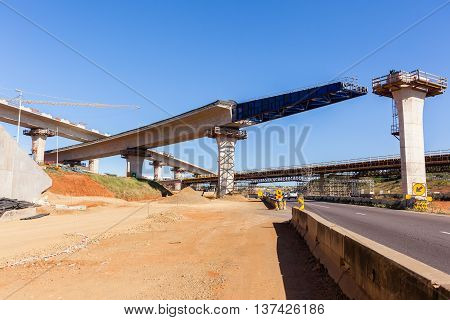 Construction industry new traffic road highway intersection junction flyover ramps  of concrete steel design.