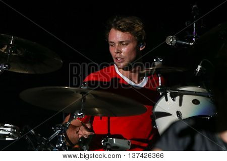HOLLYWOOD, CA-OCT 24: Ashton Irwin of 5 Seconds of Summer performs during CBS RADIOs 3rd annual We Can Survive presented by Chrysler at the Hollywood Bowl on October 24, 2015 in Hollywood, California.