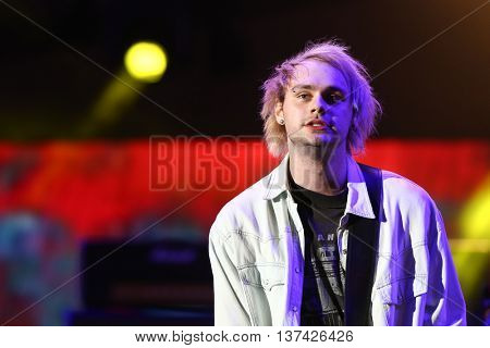 HOLLYWOOD, CA-OCT 24: Michael Clifford of 5 Seconds of Summer performs during CBS RADIOs 3rd annual We Can Survive presented by Chrysler at Hollywood Bowl on October 24, 2015 in Hollywood, California.