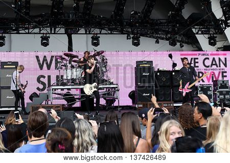 HOLLYWOOD, CA-OCT 24: 5 Seconds of Summer perform before CBS RADIOs third annual We Can Survive, presented by Chrysler, at the Hollywood Bowl on October 24, 2015 in Hollywood, California.
