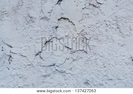 Background of a white stucco coated and painted exterior, rough cast of cement and concrete wall texture,