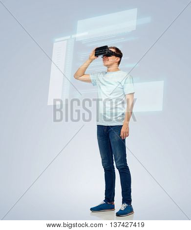 3d technology, virtual reality, entertainment, cyberspace and people concept - happy young man with virtual reality headset or 3d glasses looking at screen with coding