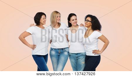 friendship, diverse, body positive, communication and people concept - group of happy different size women in white t-shirts hugging and talking over beige background