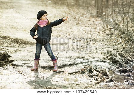 Young Girl In Rubber Boots In The Autumn Forest