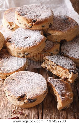 British Biscuits: Welsh Cakes With Raisins And Powdered Sugar Close-up. Vertical